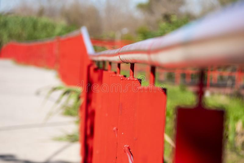 Finky Park, natural reserve recovered by the neighbors. Iron railing painted orange in escape in a public park in Temperley, a city in the suburbs of the royalty free stock photography
