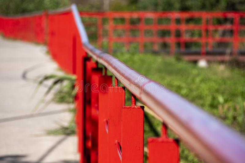 Finky Park, natural reserve recovered by the neighbors. Iron railing painted orange in escape in a public park in Temperley, a city in the suburbs of the royalty free stock image