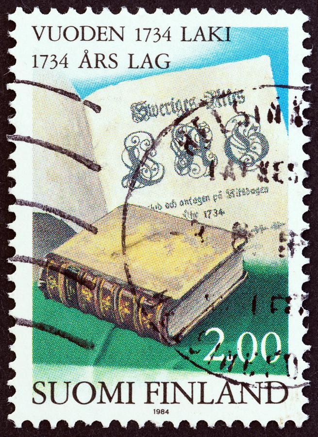 FINLAND - CIRCA 1984: A stamp printed in Finland shows Statute Book and Title Page, circa 1984. royalty free stock image
