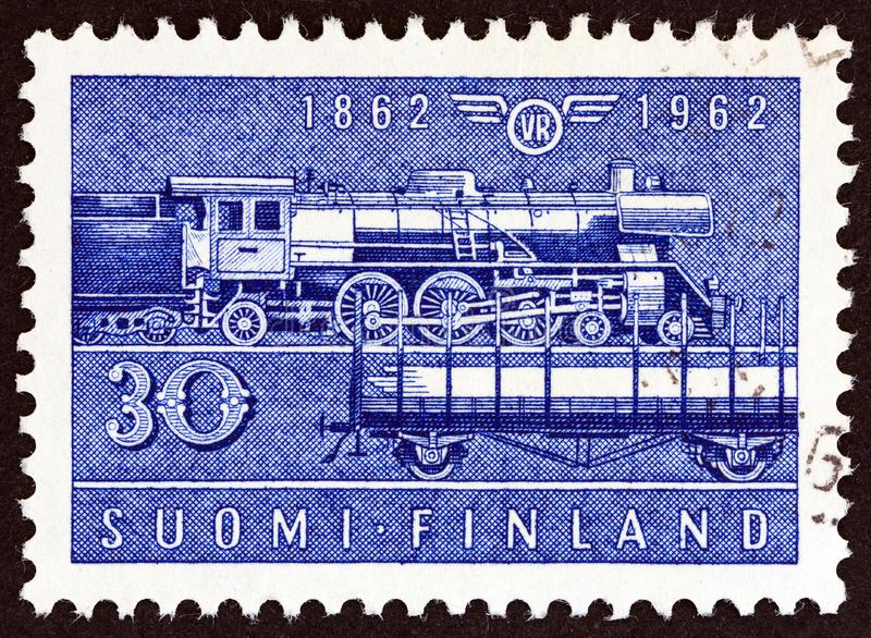 FINLAND - CIRCA 1962: A stamp printed in Finland shows Class Hr-1 steam locomotive and Type Hk wagon, circa 1962. FINLAND - CIRCA 1962: A stamp printed in royalty free stock photos