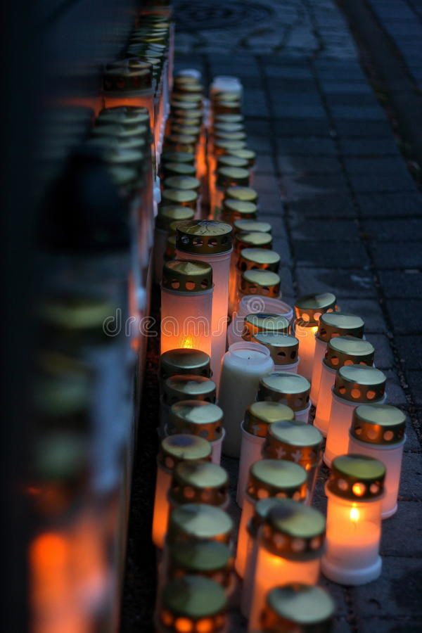 Finland: Dark Christmas. Candles in a memorial to honour our loved ones that have passed away. This is a typical tradition in Finland in Christmas royalty free stock photos