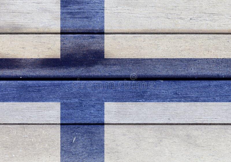Finland flagga på ett trä stock illustrationer