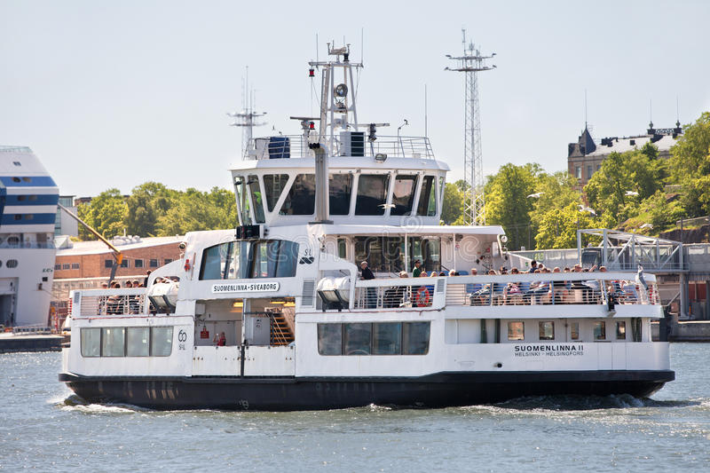 FINLAND, HELSINKI - JUNE 15, 2011: Small ferry Suomenlinna II moves tourists from Helsinki to Suomenlinna fortress royalty free stock photos