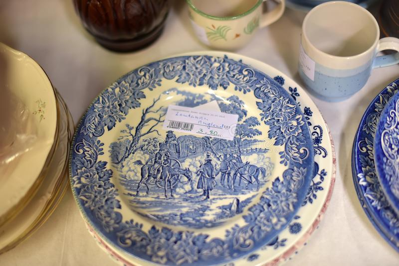 Plates of antique English porcelain in a commission shop royalty free stock image