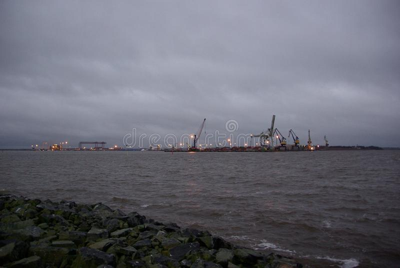 Finland, port Pori, steel pelicans, industrial landscape with lights royalty free stock photo