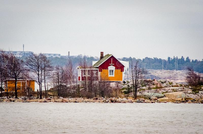 Finland red lake house scene. Very much one of the main tourist attractions and points of interest in the area stock photography