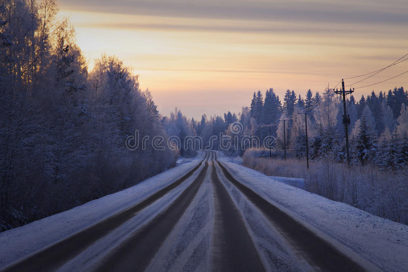 Finland: Road in winter. Winter sunset somewhere on the road in Southern Finland stock images