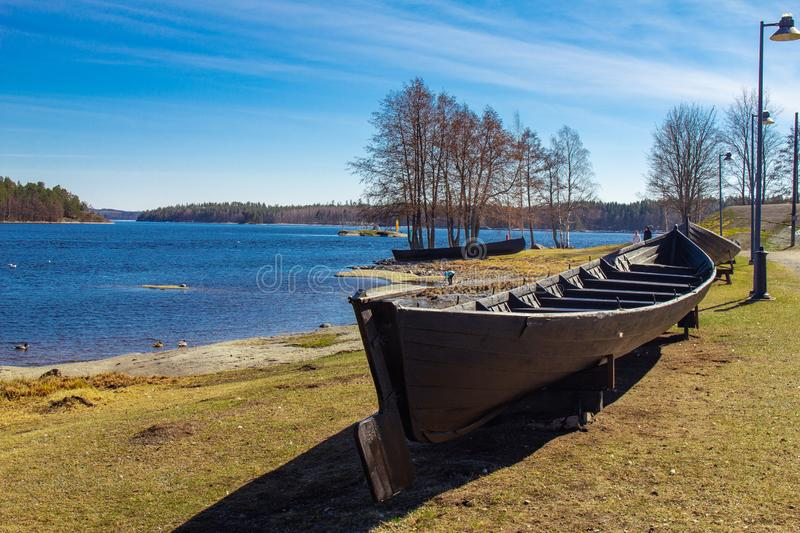 Finland. Savonlinna. Southern Savonia: Exhibit ancient boat on the lake at spring sunny day near the Lake Saimaa Nature and Museum stock images