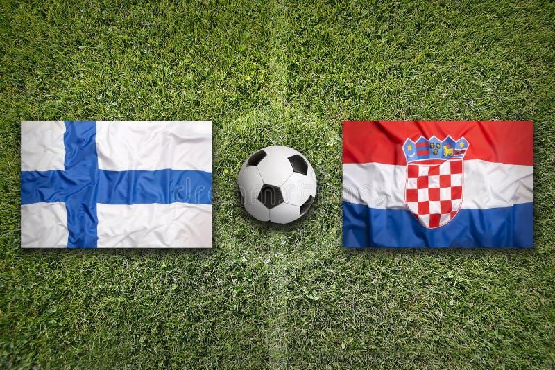 Finland versus De vlaggen van Kroatië op voetbalgebied royalty-vrije stock foto