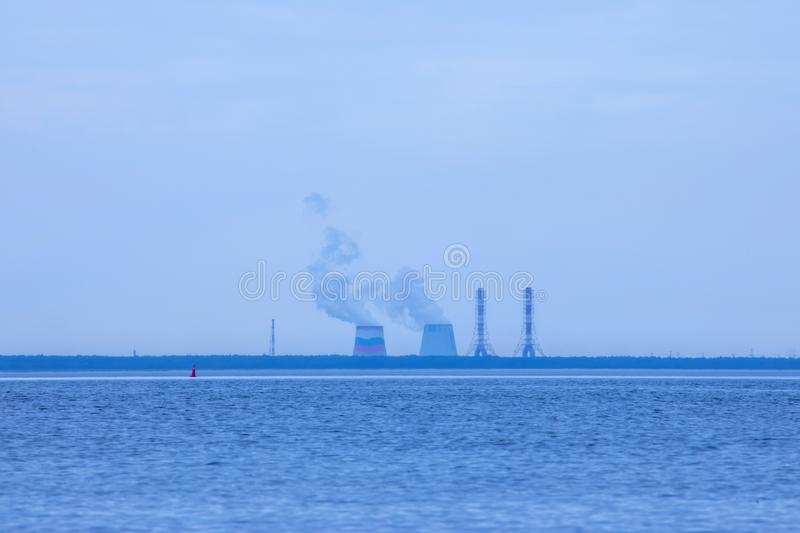 Finnish Gulf near Petersbourg in the cloudy summer day. View on the thermal power station royalty free stock photography
