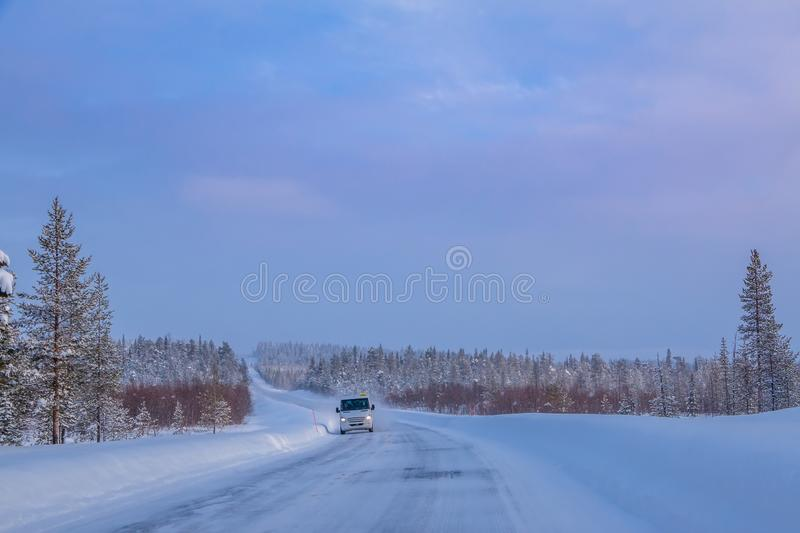 Bus on the Winter Forest Road royalty free stock photo