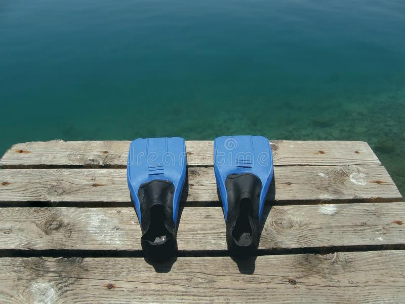 Fins blue on sea-port with green blue sea royalty free stock images