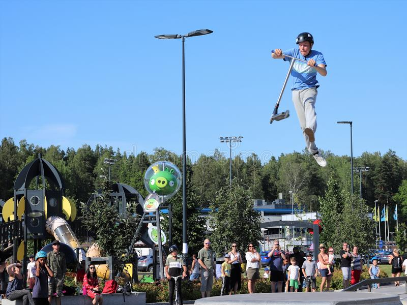 Competitor performing in National Scooter Championships 2019,  Pro-series. FinScooter Summer Jam sport event was held in Leppaevaara skate park in Espoo, Finland royalty free stock images