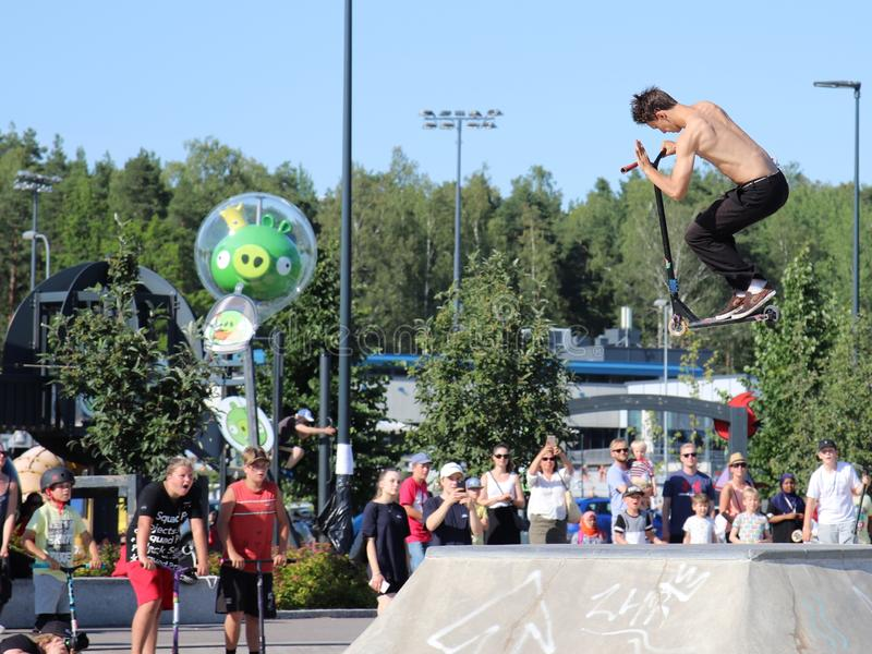 Competitor performing in National Scooter Championships 2019,  Pro-series. FinScooter Summer Jam sport event was held in Leppaevaara skate park in Espoo, Finland royalty free stock photos
