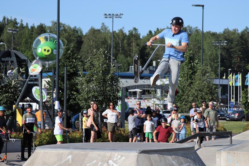 Competitor performing in National Scooter Championships 2019,  Pro-series. FinScooter Summer Jam sport event was held in Leppaevaara skate park in Espoo, Finland royalty free stock photo