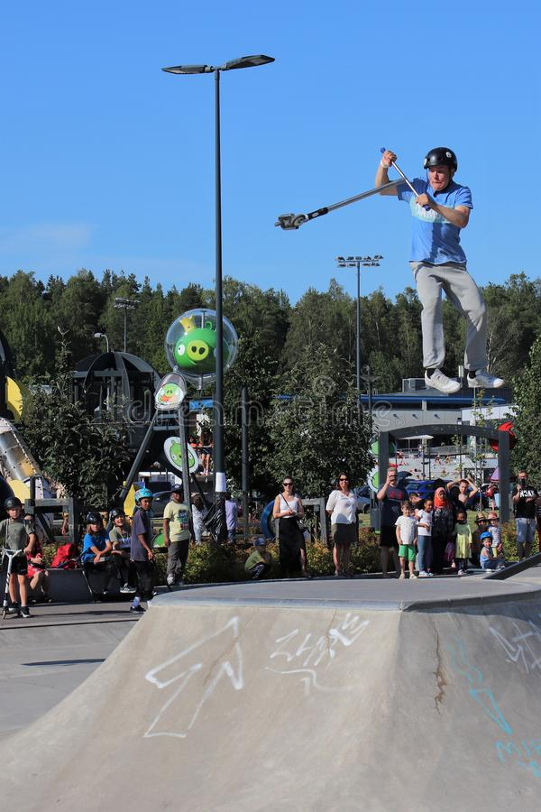 Competitor performing in National Scooter Championships 2019,  Pro-series. FinScooter Summer Jam sport event was held in Leppaevaara skate park in Espoo, Finland stock photos