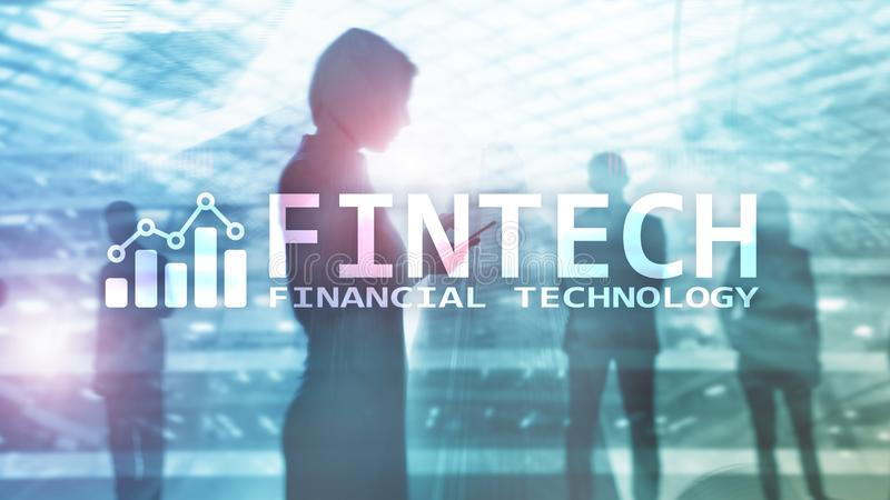 FINTECH - Financial technology, global business and information Internet communication technology. Skyscrapers stock photo