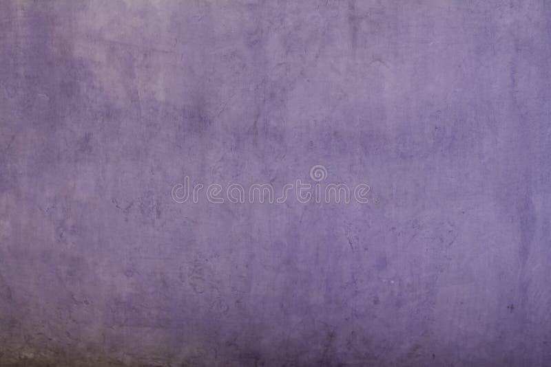 Fiołkowa stiuk ściana zamykająca w górę tekstury fotografia stock