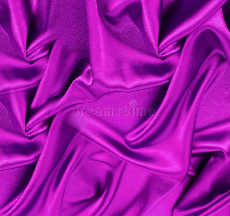Fiołkowego atłasu lub jedwabniczej tkaniny zakończenie up zdjęcie stock