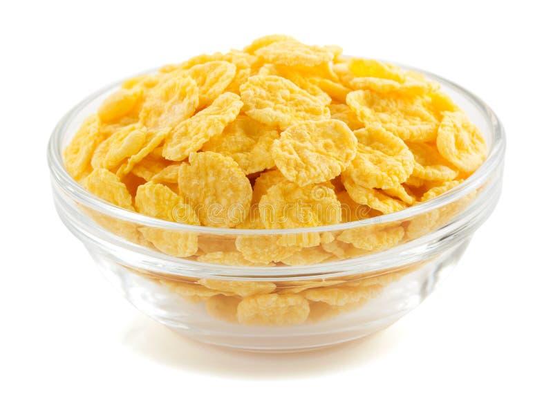 Fiocchi di mais in ciotola su bianco immagine stock libera da diritti