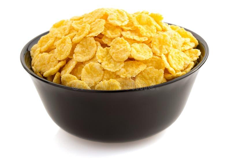 Fiocchi di mais in ciotola su bianco immagine stock