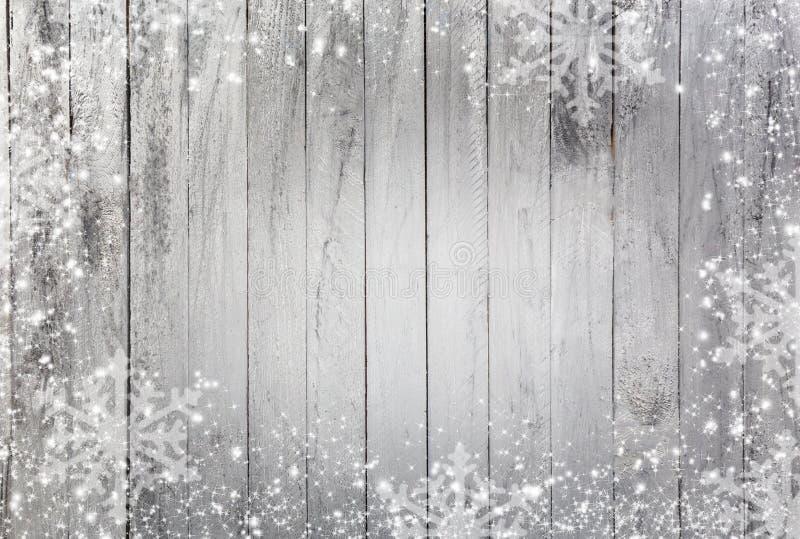 Fiocchi di neve come rasentare un fondo di legno illustrazione vettoriale