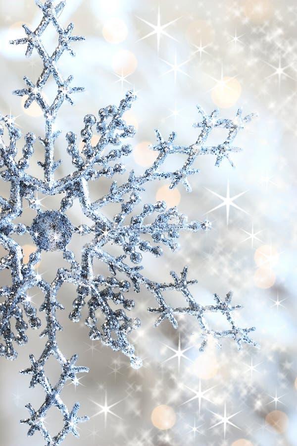 Fiocco di neve e stelle del primo piano o fotografia stock libera da diritti
