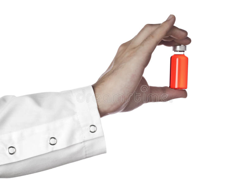 Fiole rouge sur une main images libres de droits