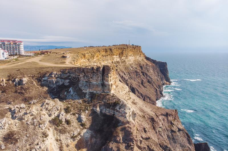 Fiolent cape, Crimea, aerial view from drone above rocky mountains and blue sea, beautiful nature landscape from above. In sunny day stock photography