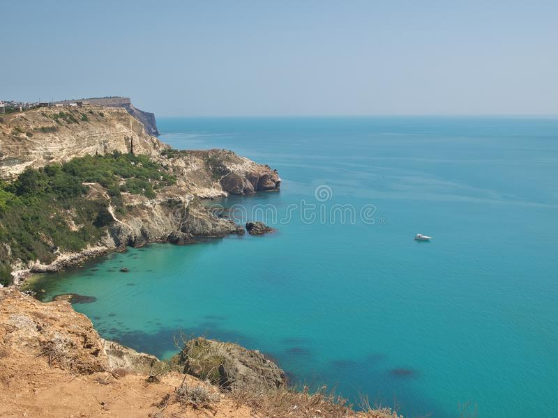 Fiolent cape Sebastopol, Crimea, Russia. Fine summer day on Fiolent cape. Hot sun and blue sea around you royalty free stock images