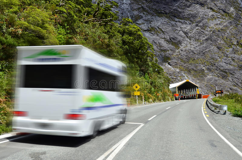 Fiordland - Homer Tunnel. FIORDLAND,NZ - JAN 14:Campervan enters Homer Tunnel on Jan 14 2014.It's a 1.2km (0.75 miles) road tunnel and until it was sealed and royalty free stock photos