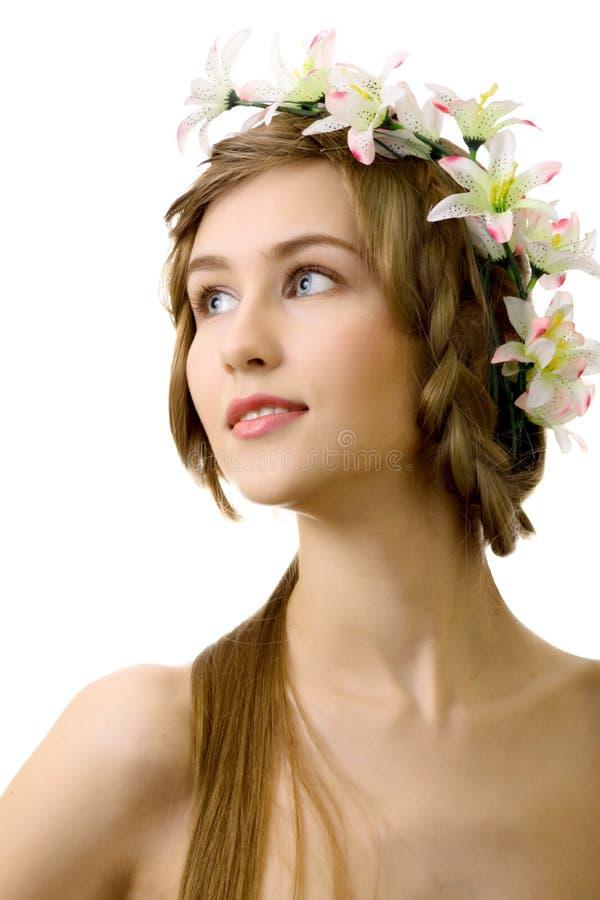 Fiore della donna di Beautyful su priorità bassa bianca immagini stock libere da diritti