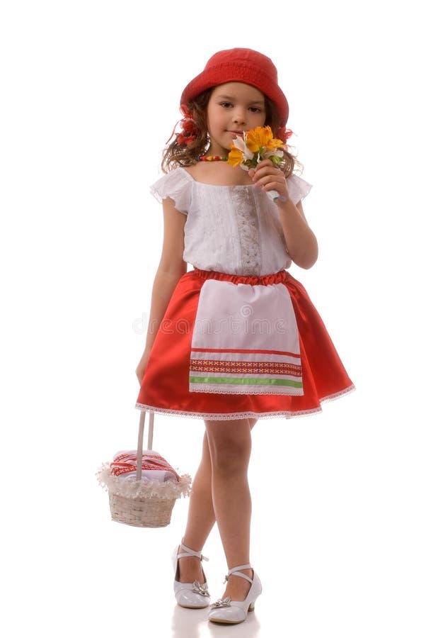 Fiore della holding della bambina fotografia stock libera da diritti
