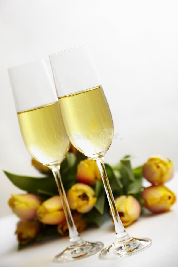 Fiori e champagne immagine stock