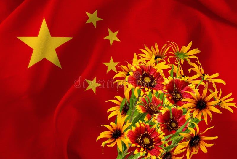 Fiori festivi sullo sfondo della bandiera della Cina fotografia stock