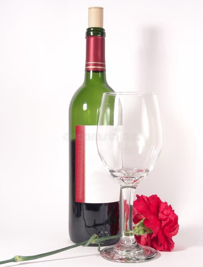 Fiorisca il vetro da bottiglia del vino immagine stock