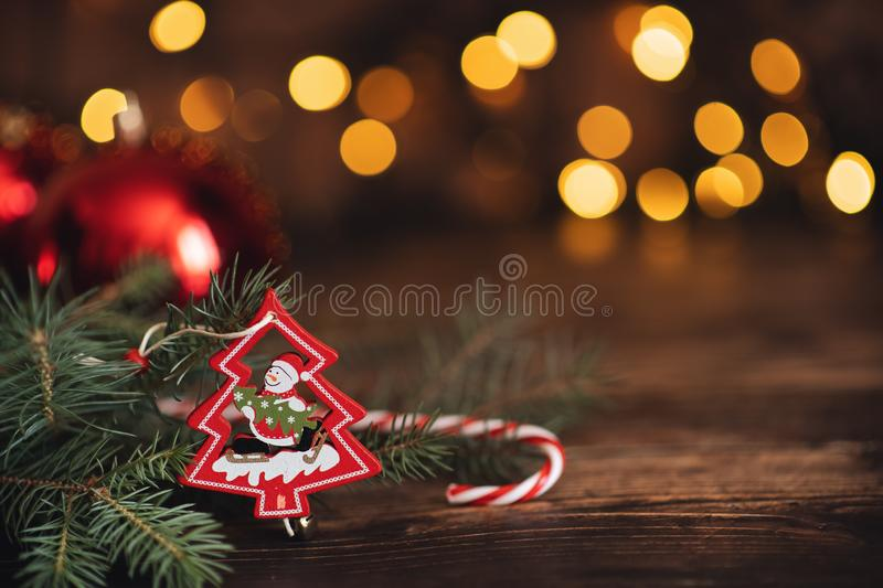Fir branch with balls and festive lights on the Christmas background with sparkles royalty free stock photo