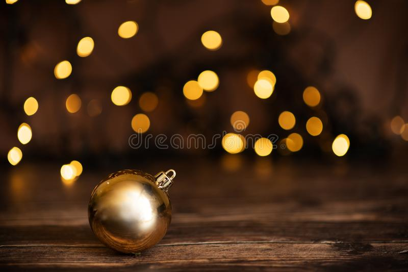 Fir branch with balls and festive lights on the Christmas background with sparkles royalty free stock photography