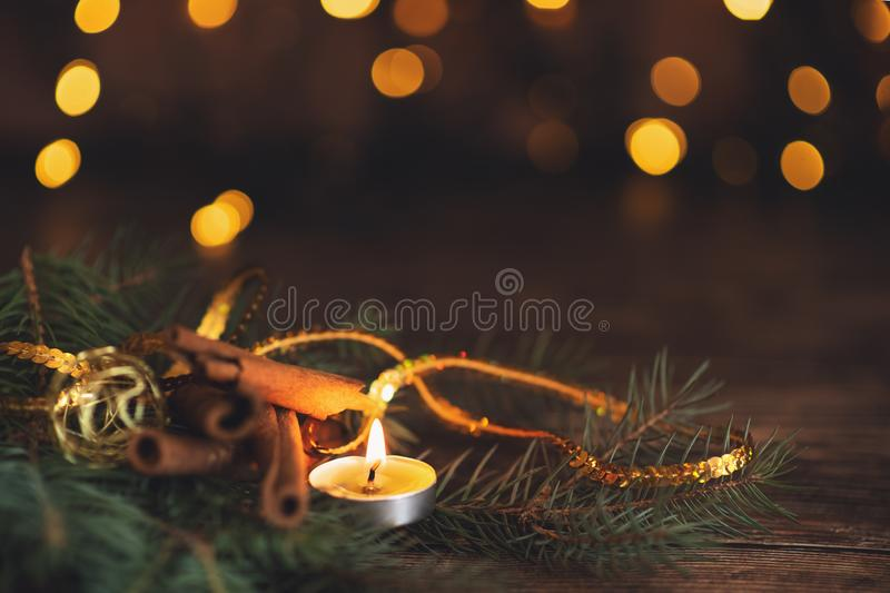 Fir branch with balls and festive lights on the Christmas background with sparkles.  royalty free stock photography