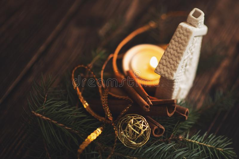 Fir branch with balls and festive lights on the Christmas background with sparkles.  stock image