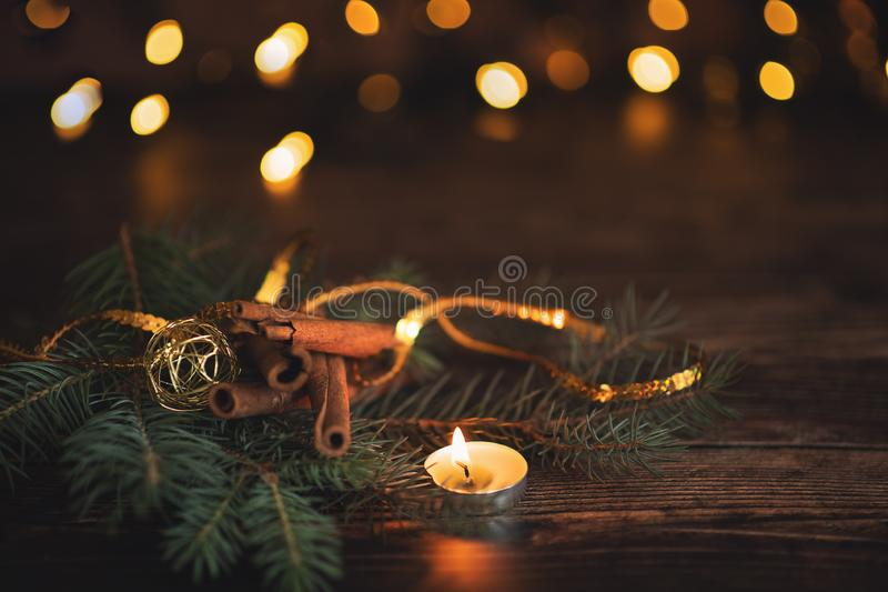 Fir branch with balls and festive lights on the Christmas background with sparkles.  stock photos