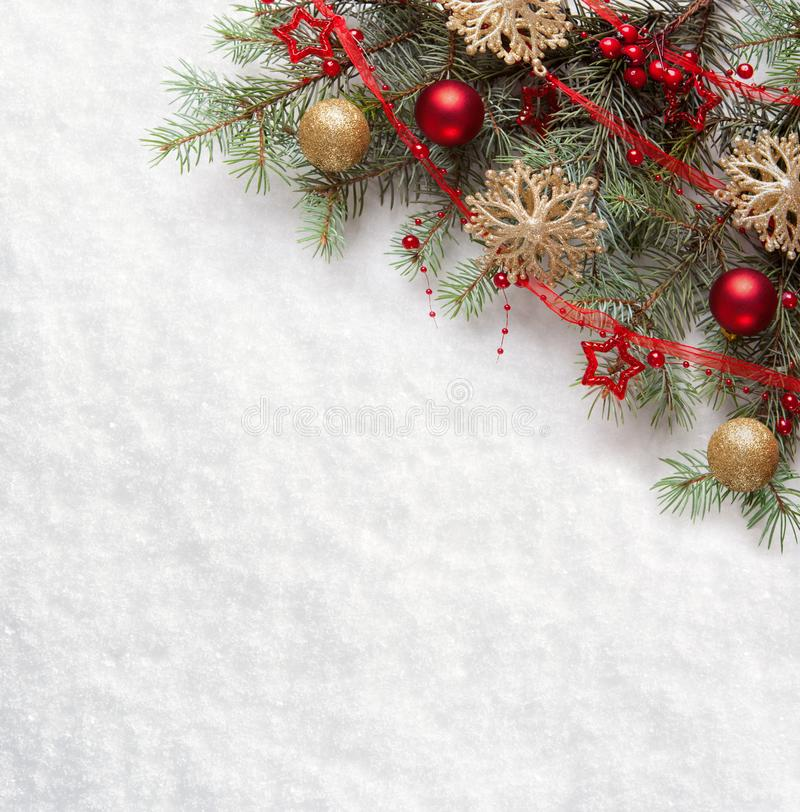 Fir branch with Christmas decorations on the background of natural snow.  royalty free stock photos