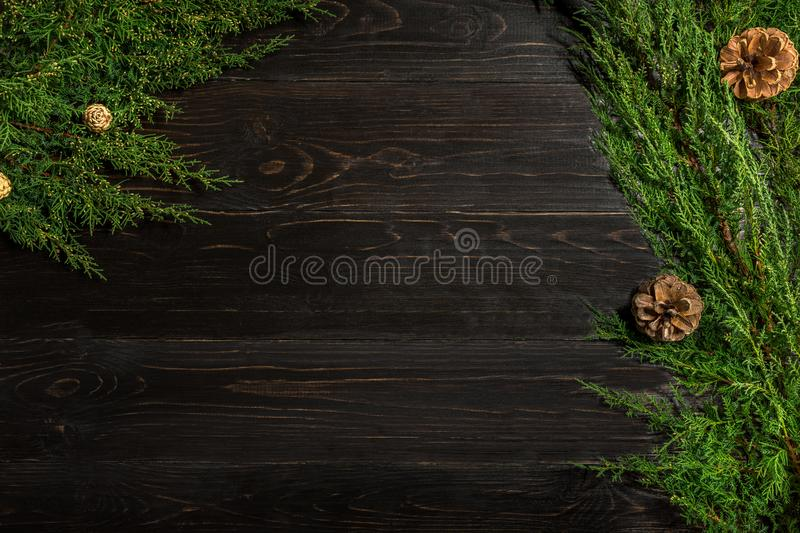 Fir branches border on black wooden background, good for christmas backdrop. Free space for text. top view. Copy space. Closeup stock photography