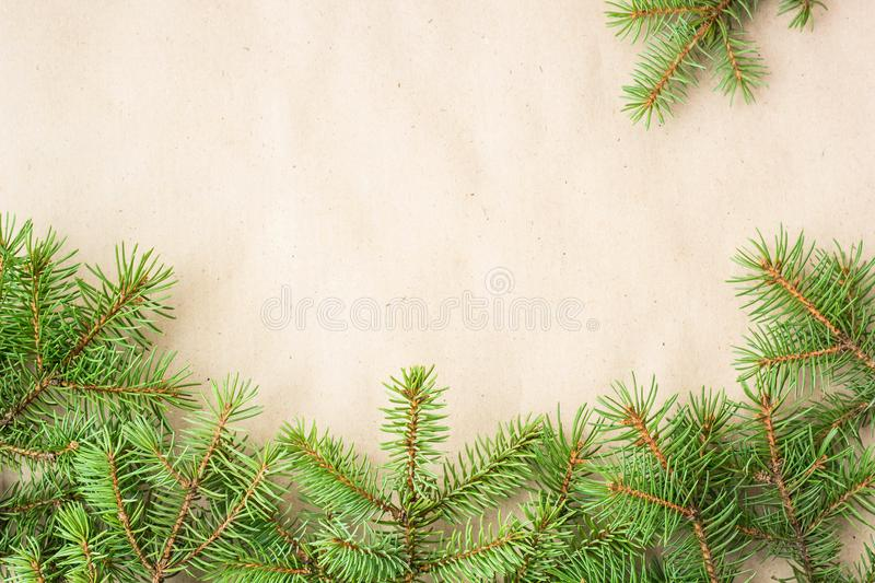 Fir branches border on light rustic background, good for christmas backdrop.  stock photos