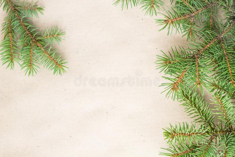 Fir branches border on light rustic background, good for christmas backdrop.  stock photography