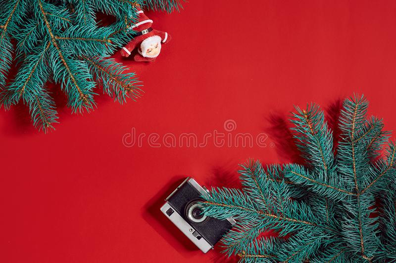 Fir branches border on red background, good for christmas backdrop. Top view. Flat lay. Copy space. Still life. Christmas and New year royalty free stock photo