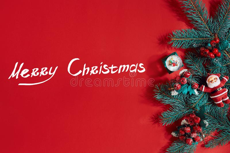 Fir branches border on red background, good for christmas backdrop. The inscription - Merry Christmas royalty free stock photography