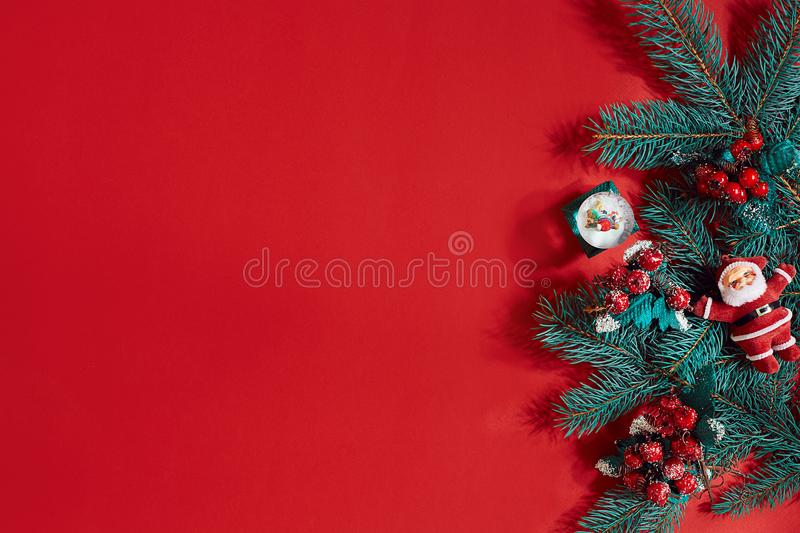 Fir branches border on red background, good for christmas backdrop stock photo