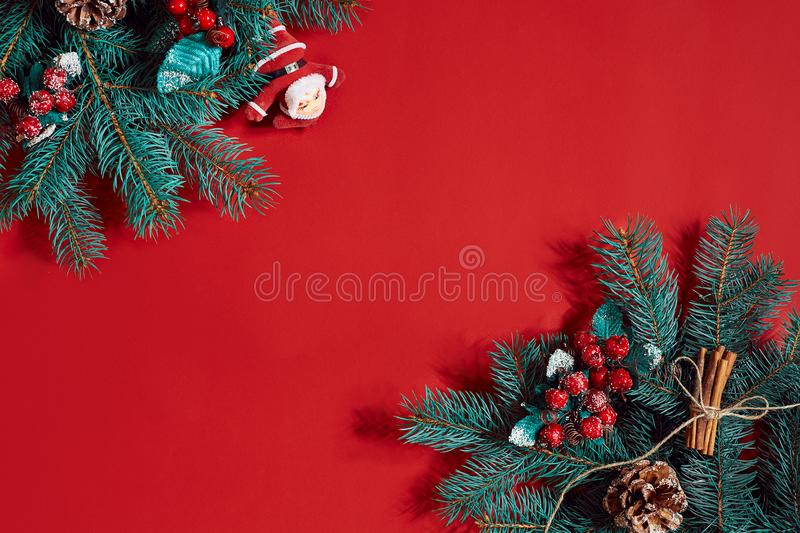 Fir branches border on red background, good for christmas backdrop. Top view. Flat lay. Copy space. Still life. Christmas and New year royalty free stock photography