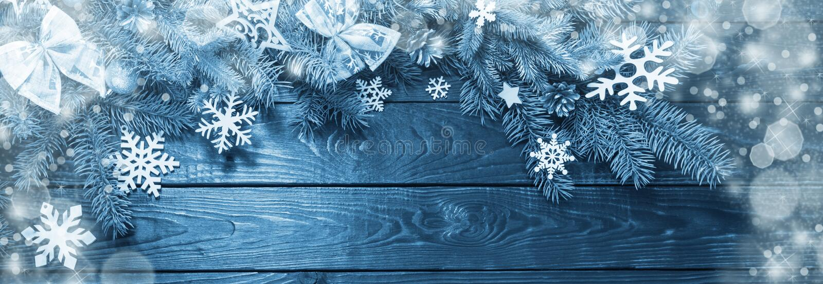 Fir branches with Christmas decor on old dark wooden background royalty free stock image